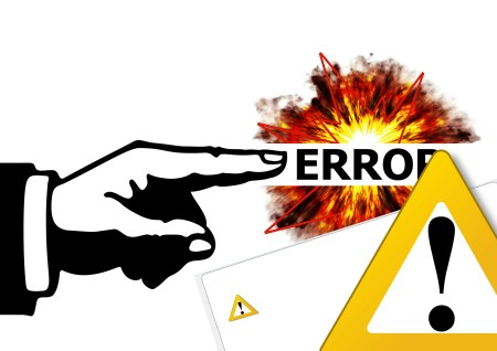 Finger pointing to the word Error