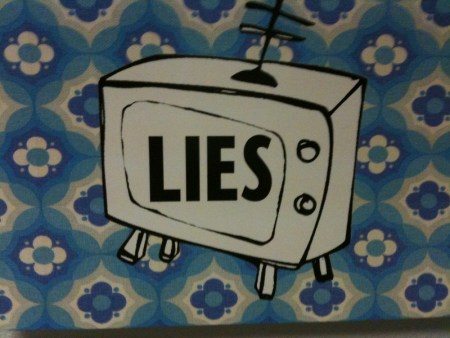 A TV with the word LIES
