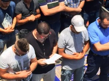 Photo Of Catholic Christian Man Praying With Muslims