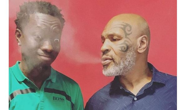 Michael Blackson pictured with Mike Tyson