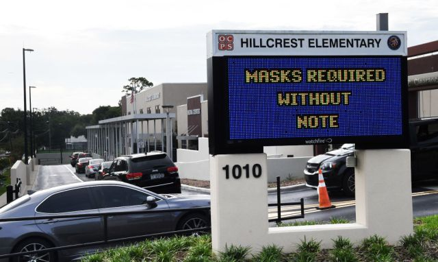 Parents drop their kids off at Hillcrest Elementary school...