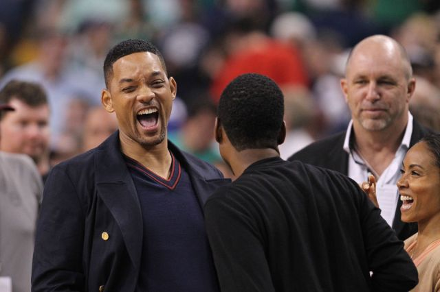 Boston, MA - Comedian/actor Chris Rock, center, gets a laugh out of Will Smith and Jada Pinkett-Smith at Game 5 of the Eastern Conference Semifinals at TD Garden on Monday, May 21, 2012. Staff Photo by Matthew West.