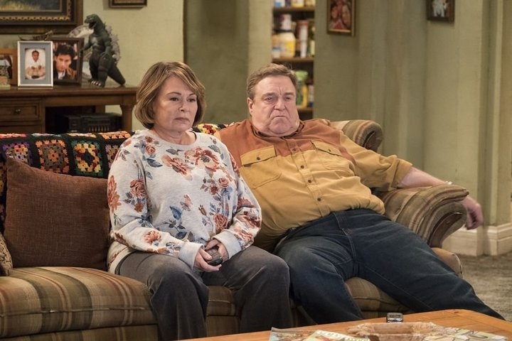 "Roseanne Barr and John Goodman in ""Roseanne."""