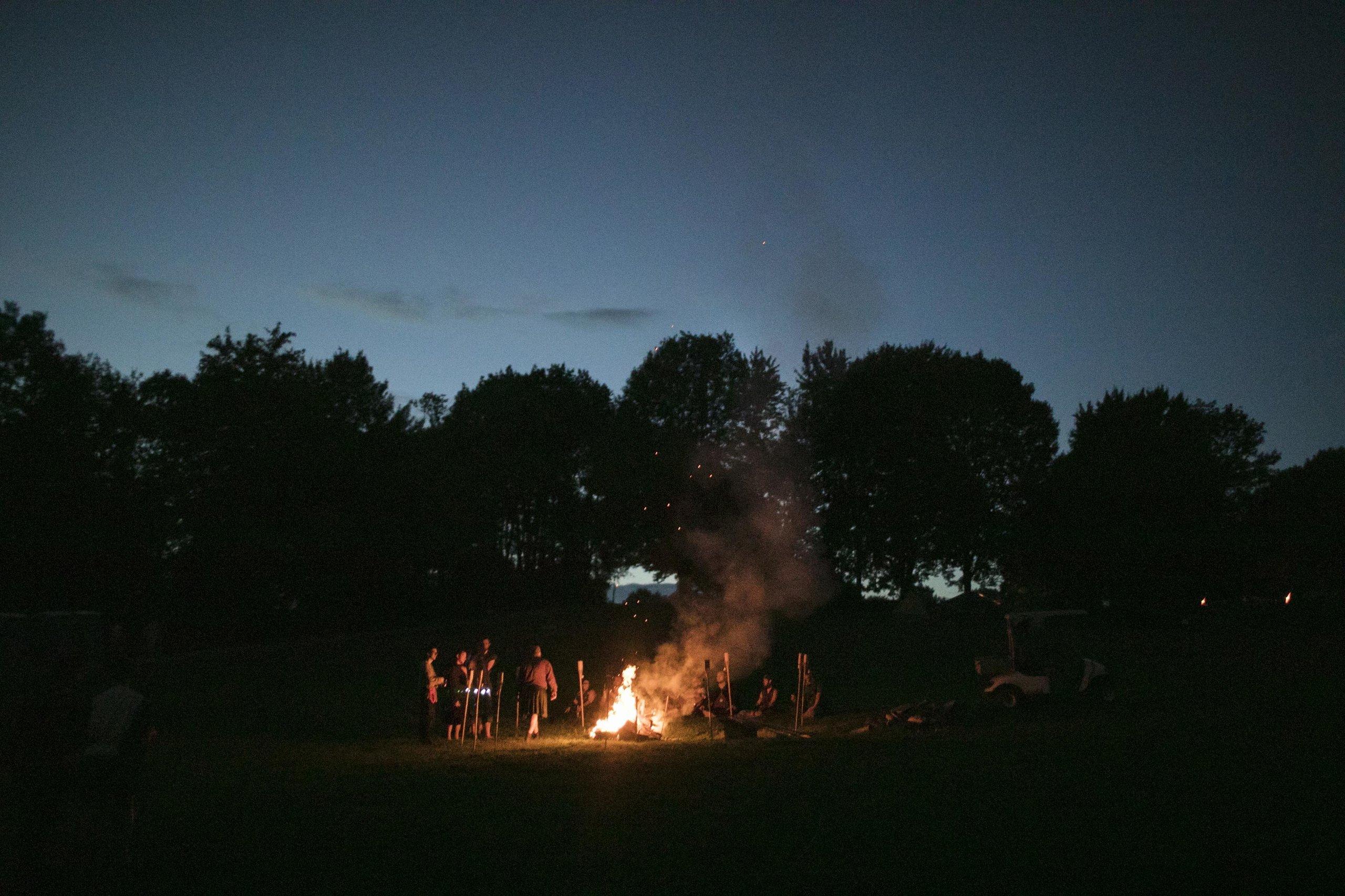 A bonfire rages after dark at Ragnarok.