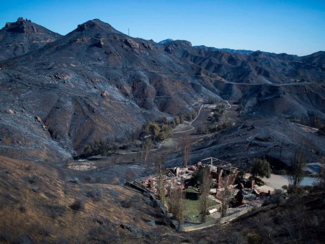 PHOTO: The Santa Monica Mountains are seen left blackened by the Woolsey Fire near Malibu, Calif., Nov. 14, 2018.