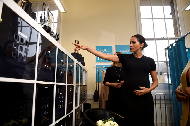 Meghan picks out a bracelet during her visit.