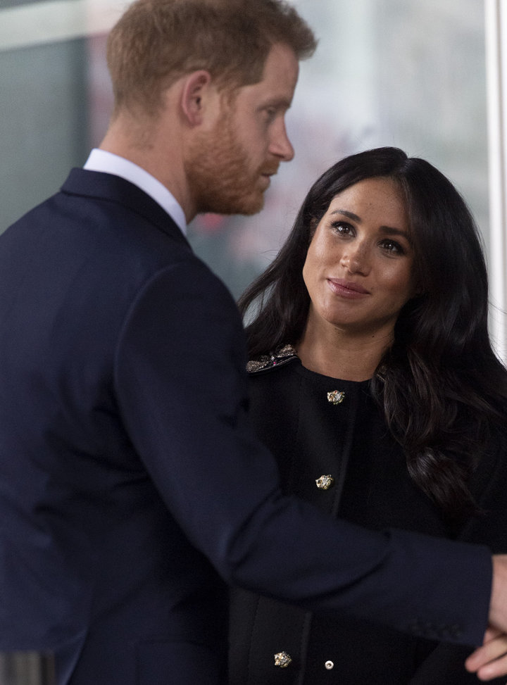 Meghan looks up at Harry during the stop on Tuesday.