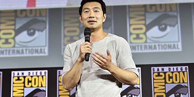 "Simu Liu of Marvel Studios' ""Shang-Chi and the Legend of the Ten Rings"" speaks at the San Diego Comic-Con International 2019 Marvel Studios Panel in Hall H on July 20, 2019. He called his casting the ""craziest dream."""