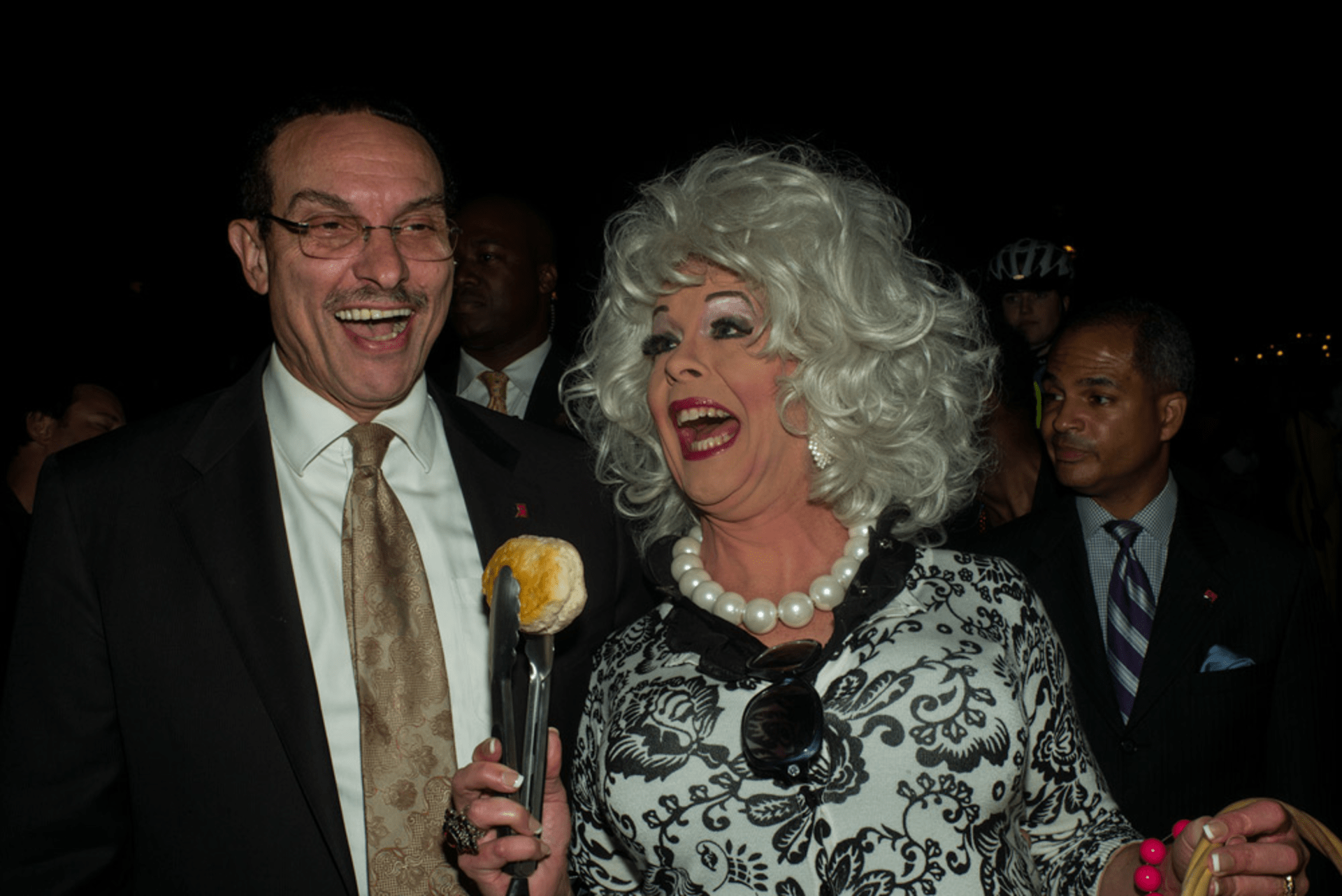 Mayor Vincent C. Gray and Philip Gerlach, who is dressed as Paula Deen at the 27th annual 17th Street High Heel Race.