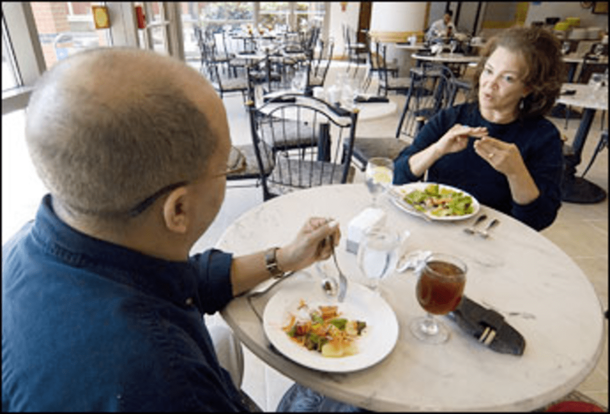Show of Hands: Bistro patrons Michael Bird and Judy Stout