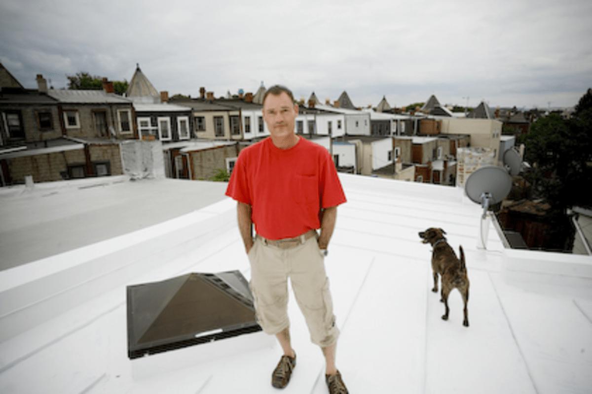 John Henson on his white roof in Bloomingdale.