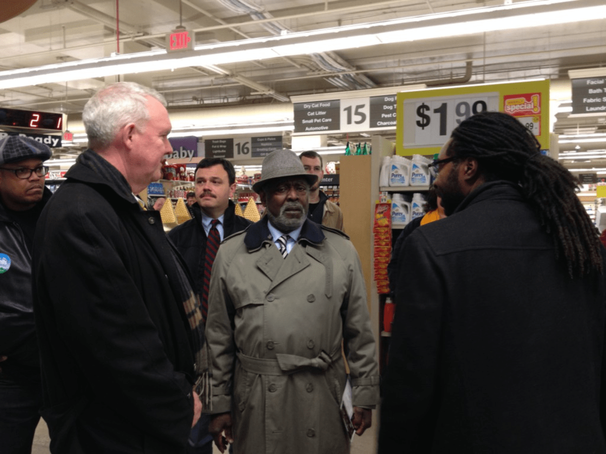 Metropolitan Washington Council head Joslyn Williams (center) with Tommy Wells last year