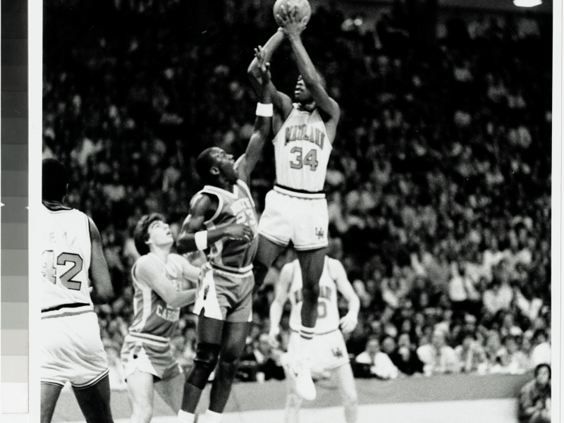 Len Bias attempts a jump shot over Michael Jordan during their college years.