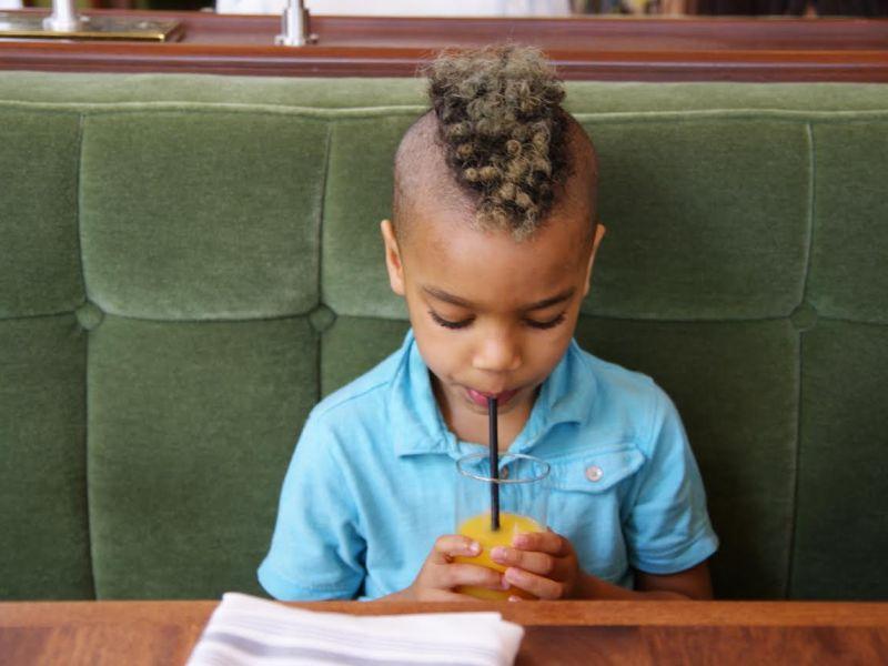 Seven-year-old Zephyr drinking a soda