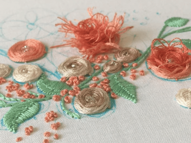 Embroidered flowers and leaves on cloth