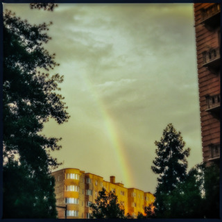 rainbow over building