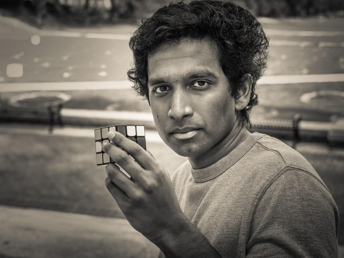 Pavan Ravindra with Rubik's cube