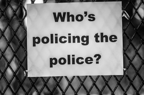 Who's policing the police? sign