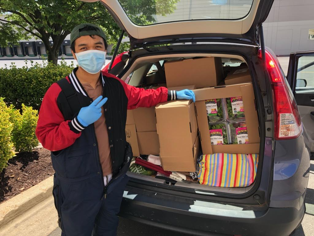 A volunteer's car full of rescued food
