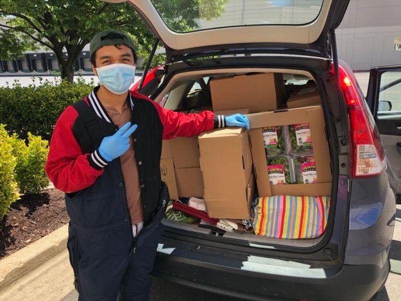 A volunteer's car full of rescued food