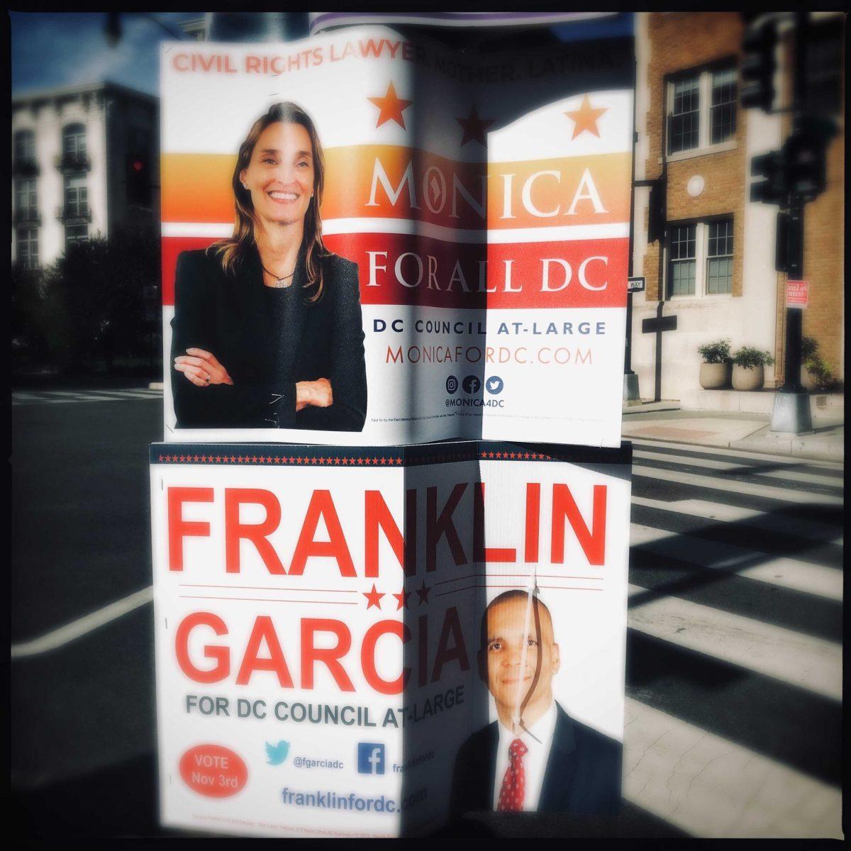 Campaign signs for Monica Palacio and Franklin Garcia