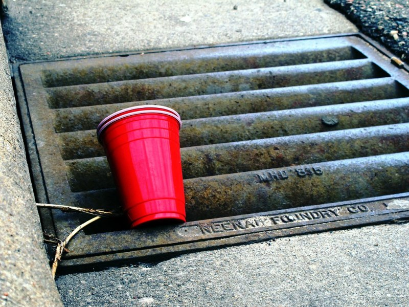 Red plastic cup on the ground