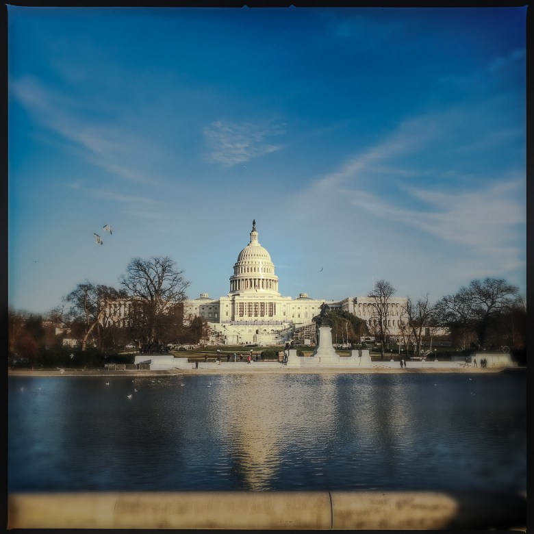 United States Capitol building seen from across the reflecting pool