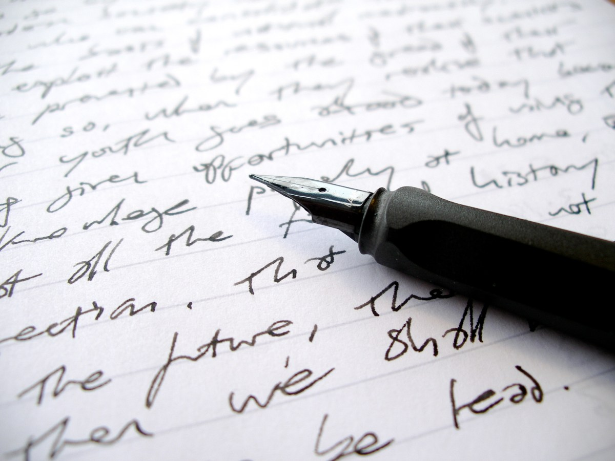 A pen on paper, like you might use for the Sonnet Crash Course.