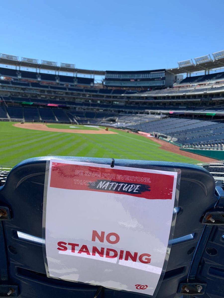 "Sign at Nats park reading ""No Standing"" with field in background"