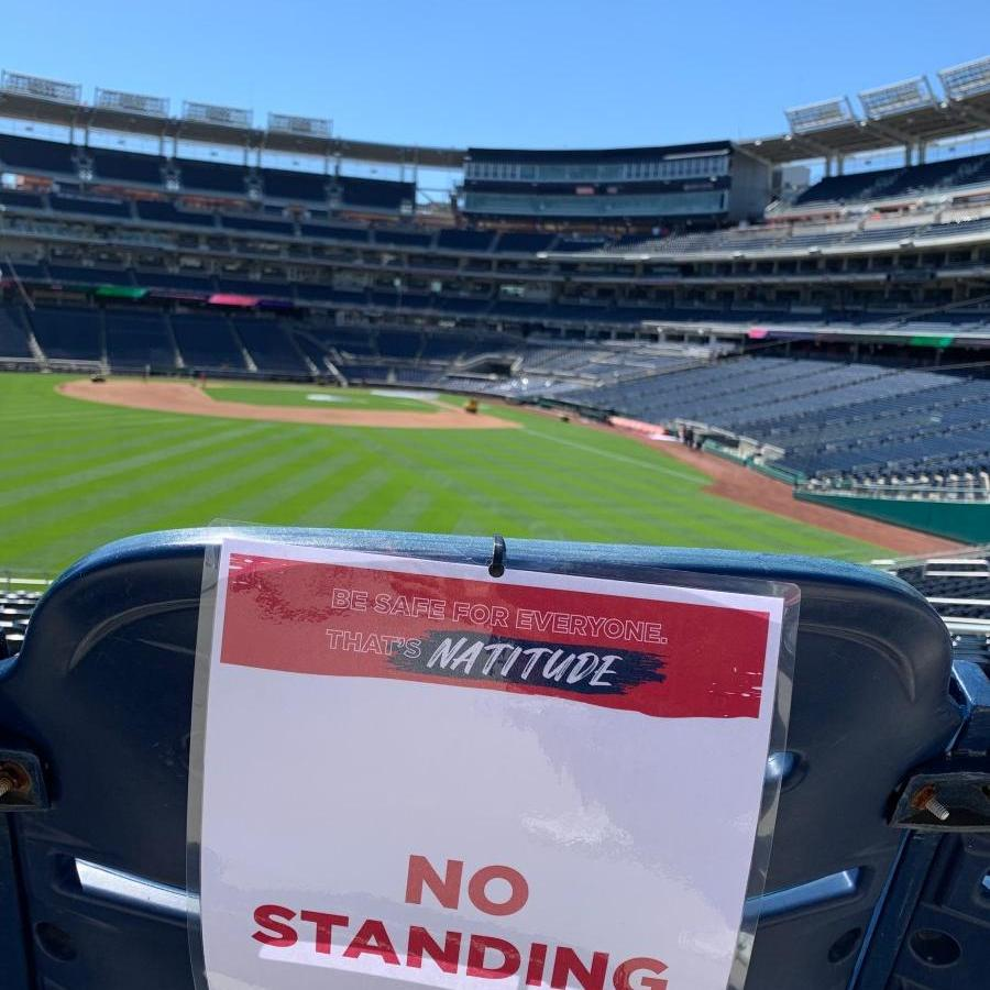 """Sign at Nats park reading """"No Standing"""" with field in background"""