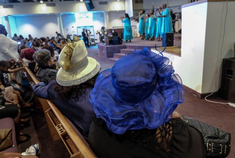 Vi Pointer and Rev. Barbara Walker watch Angela Robinson & High Praise