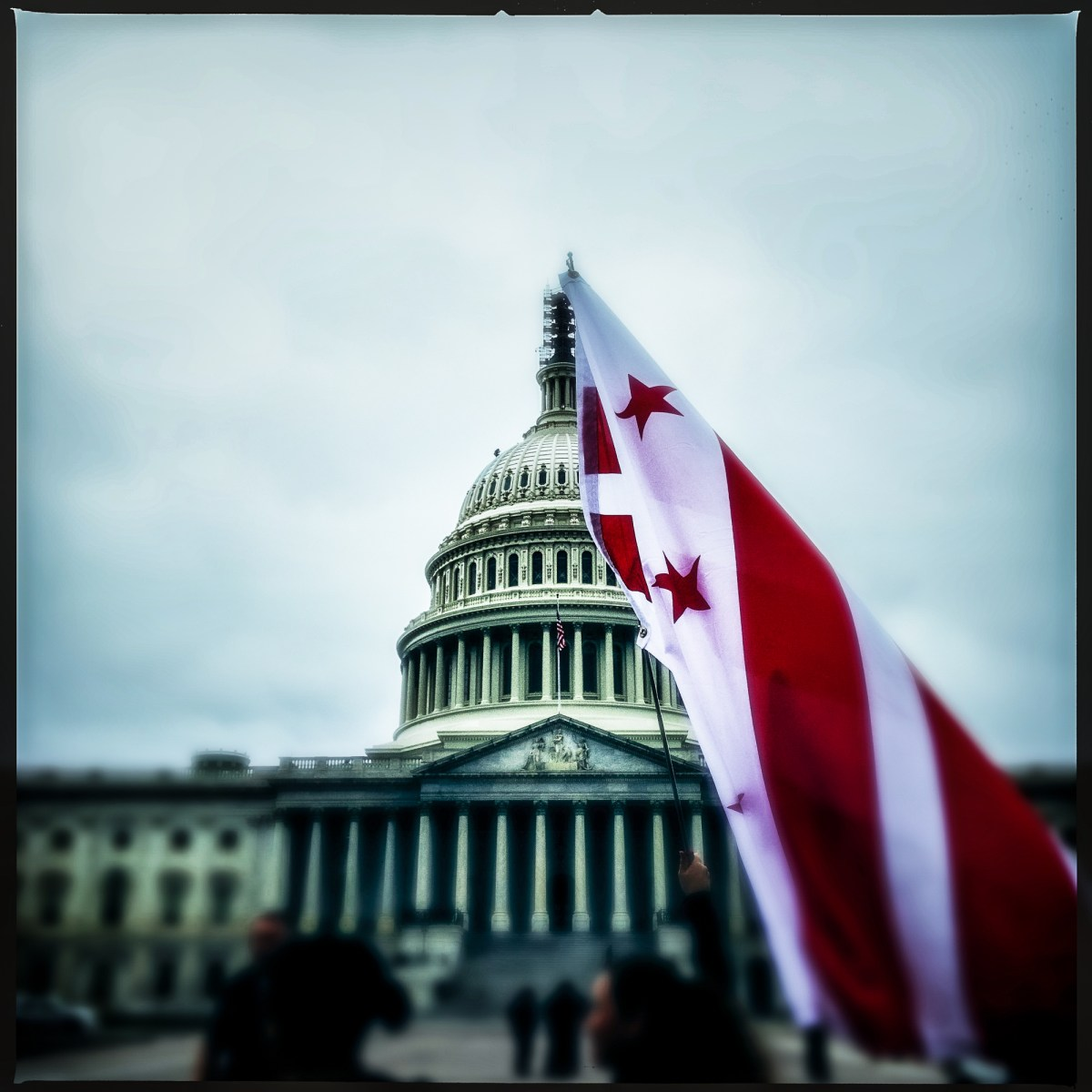 The D.C. flag being waved outside the U.S. Capitol