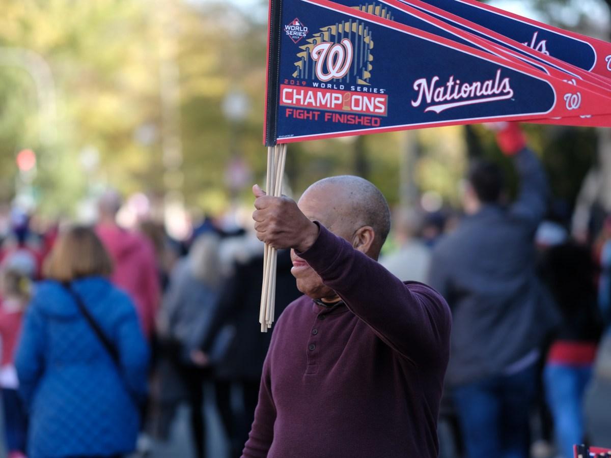 Man holding Washington Nationals pennant