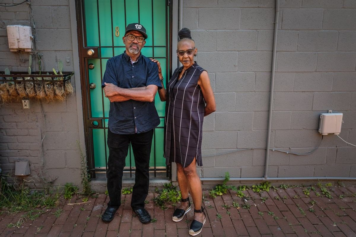 Wayson Jones and Michelle Parkerson in front of the now-shuttered ENIKAlley Coffeehouse.