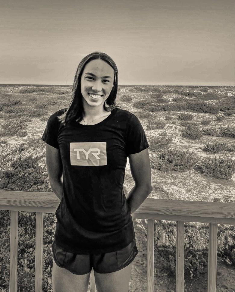 College athlete Torri Huske poses wearing a TYR shirt