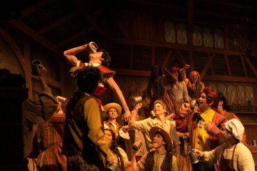 Gaston (Grant Garcia,10 ) shows off to villagers in order to regain confidence from being rejected from Belle.
