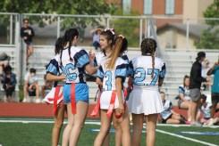 Senior girls huddle up on the field before going against the junior girls.