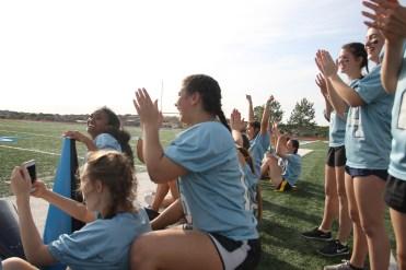 Junior girls cheer for the junior boys performance.