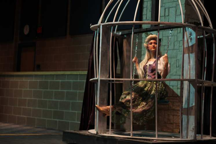 Maddie Grimm, playing Titania, swings on the swing in the birdcage before the show. Photo by Arianna Michaud