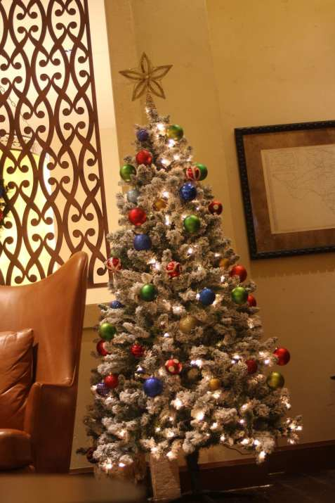 Santa's Christmas tree in his room is white as the snowflakes that fall on his beard.