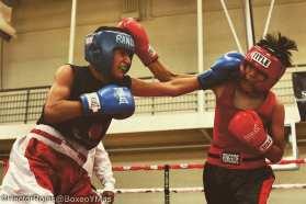 Senior Kevin Mendoza fighting hard in the ring.