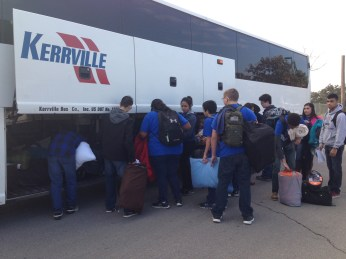 Junior ROTC cadets packing their luggage onto the bus before take off to the USS Lexington in Corpus Christi.
