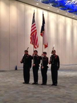 The color guard performing their sequence. Gregory Barba, Aiden Cruz, Madison Wall, Eduardo Santos