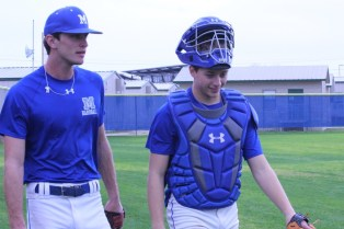 Seniors Ethan Gottschalk (left) and Jared maxson (right) warming up at the Clemens scrimmage