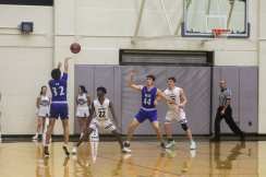 Senior Anthony Reyes Shoots the ball from the three point line.