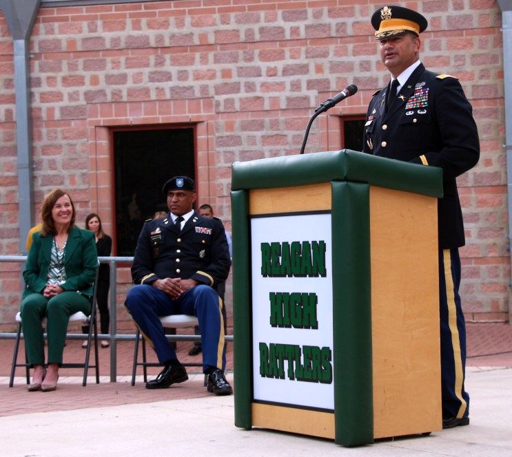 Principal Brenda Shelton and Col. Chad Livingston listen to Col. Ricardo Morales' speech to the cadets of ROTC.