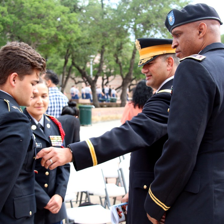 C/MAJ Isaac Chasse, C/LTC Chloe Hernandez, Col. Ricardo O. Morales, and Col. Chad Livingston are congratulating Chasse on his accolades for his participation on the drill team, at the Celebration for 100 Years of Leadership Excellence on April 26, 2016.
