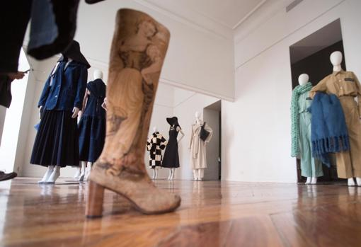 In the foreground, boots made from an ancient tapestry