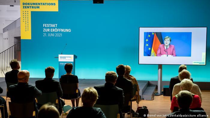 Angela Merkel speaks via video link