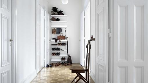 A shelf with a shoe rack.